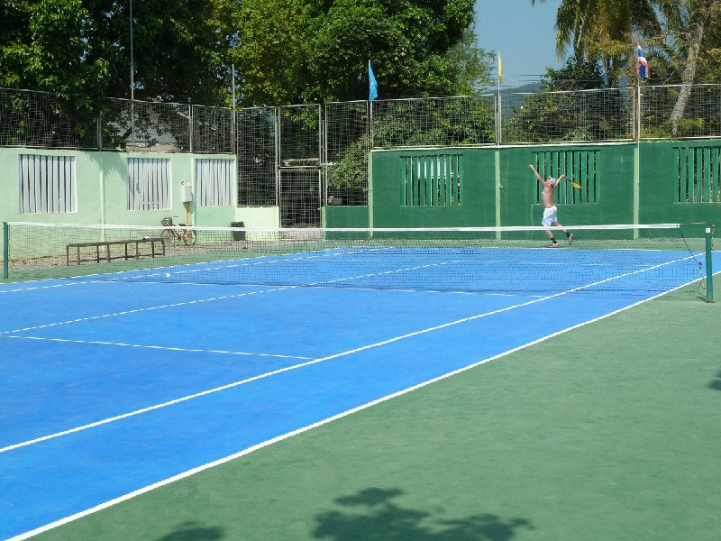 We managed to find one tennis club on this tropical island paradise. The Koh Chang Tennis Club is well maintained, lit for night play and very reasonably priced. It's located in central Khlong Proa on the west coast of Thailand's second largest island. The staff is very friendly and they can provide you with racquets, balls and cold towels if you need. Give them a call to make a reservation, or have your hotel front desk arrange it for you. Koh Chang Tennis Club is open from 0700 to 2200 everyday. Call them at 084-892-6992 or email at a7lek@mail.ru