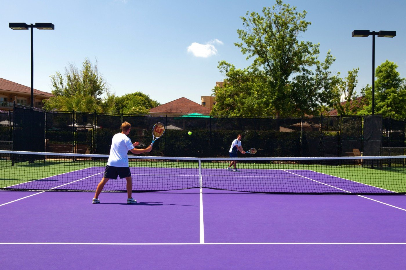tennis-tourist-courtesy-dallas-four-seasons-tennis-courts-outdoor-players-on-court