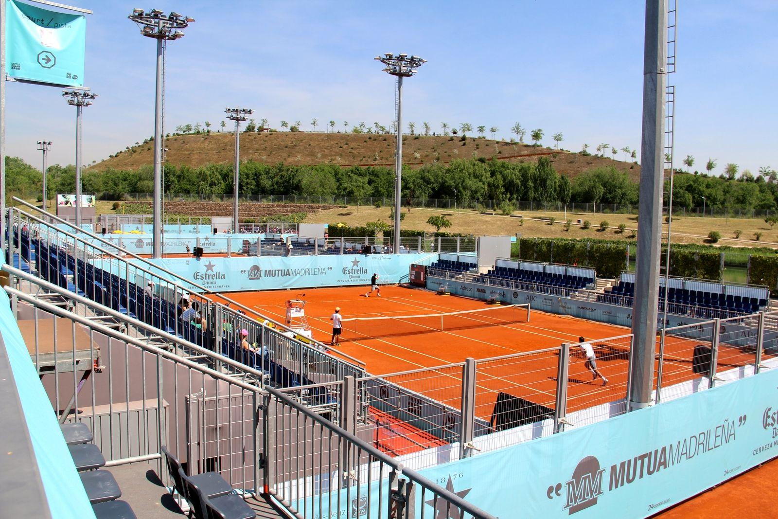 tennis-tourist-caja-magica-madrid-tennis-court-and-mountain-teri-church