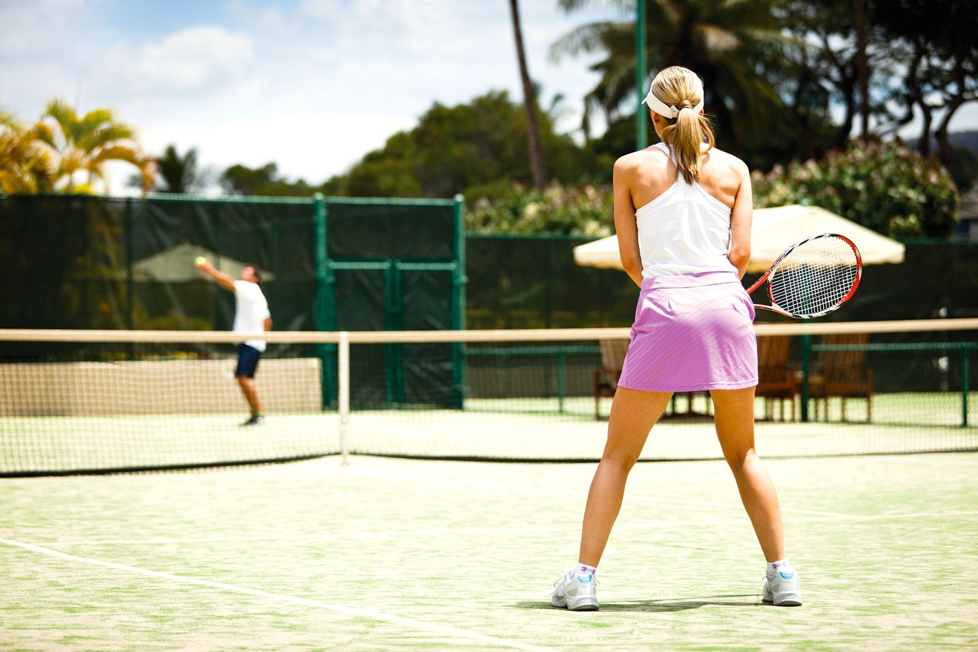 tennis-tourist-courtesy-four-seasons-maui-Woman-playing-tennis