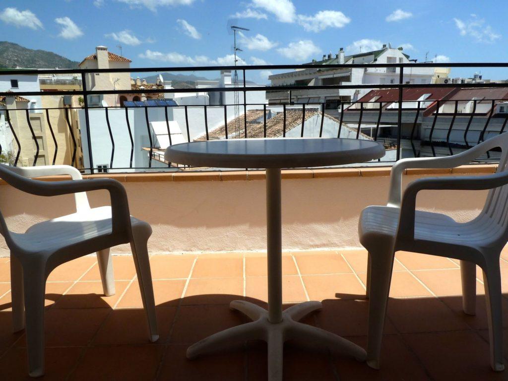 tennis-tourist-marbella-spain-hotel-lima-patio-teri-church