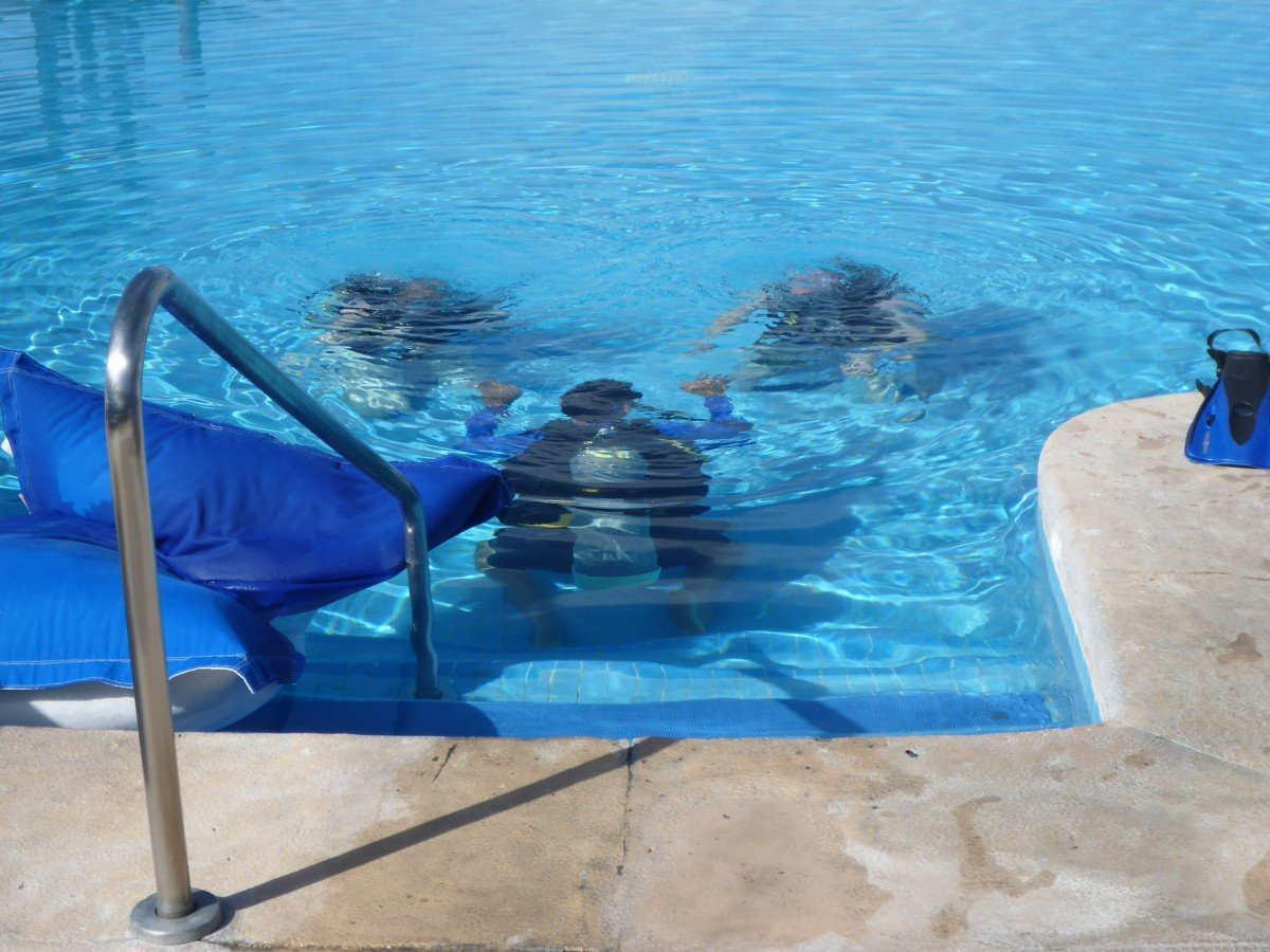 tennis-tourist-punta-mita-mexico-divers-pool-bill-adair