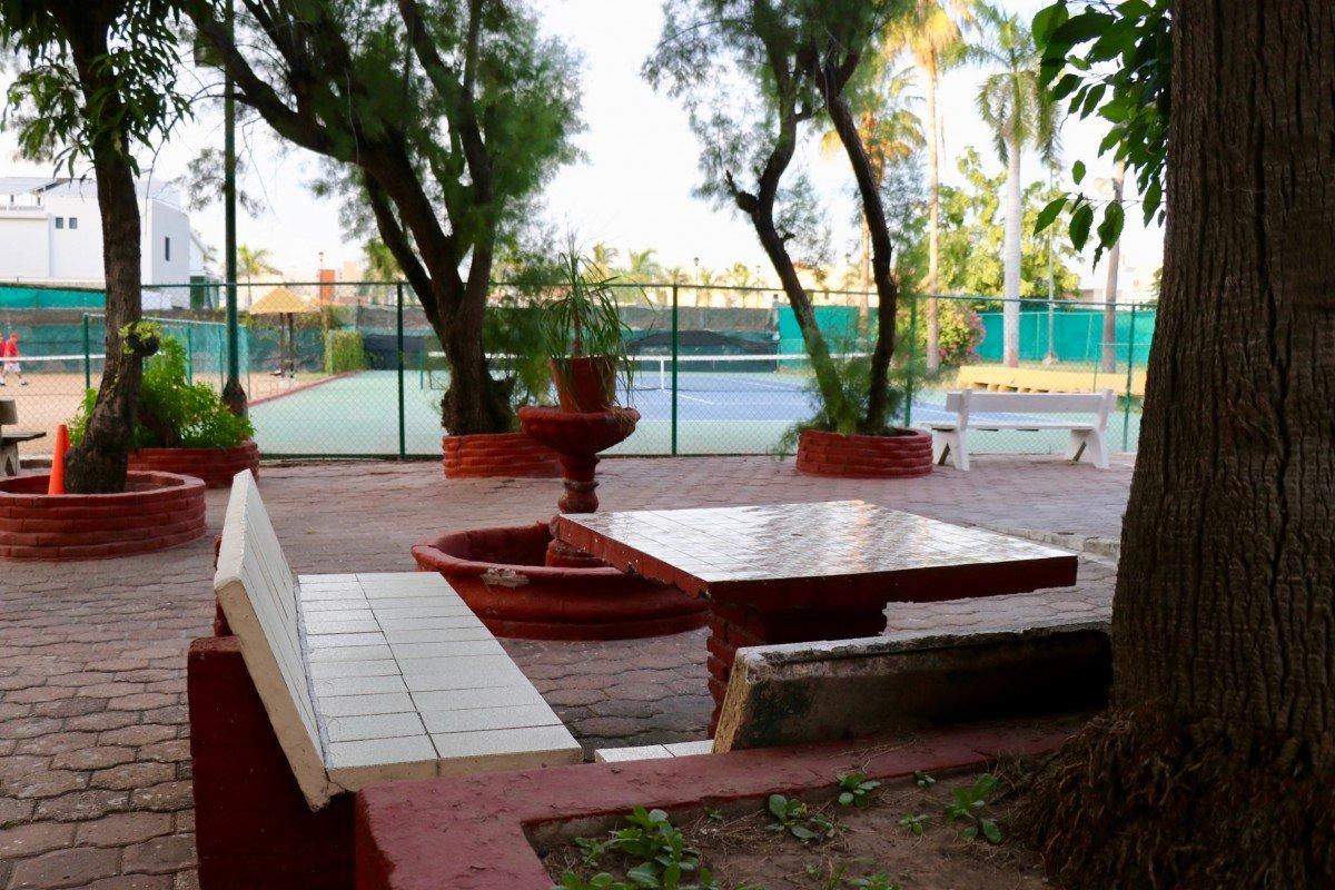tennis-tourist-mazatlan-las-gaviotas-stone-bench-court-teri-church