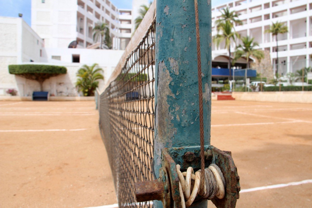 tennis-tourist-la-marina-mazatlan-mexico-clay-court-net-teri-church